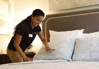 Senior living community with housekeeping and linens service at Aston Gardens At Pelican Pointe