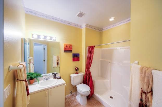 Perfectly designed bathrooms at Aston Gardens At The Courtyards in Sun City Center, FL