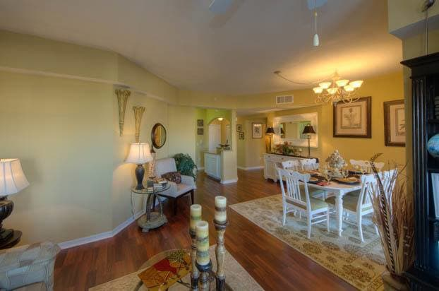 Your new living room at Aston Gardens At Pelican Pointe