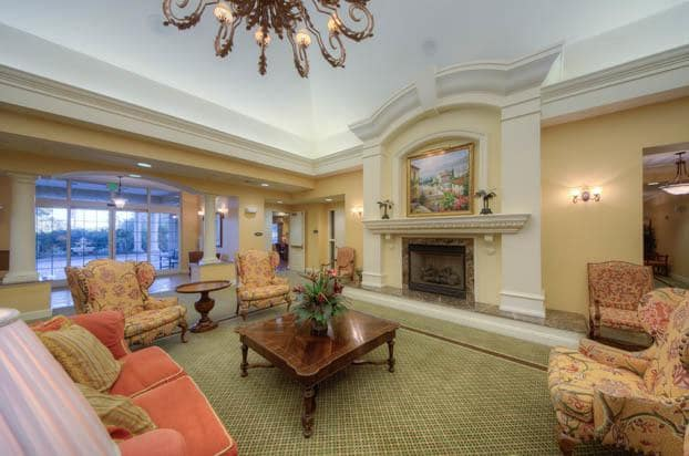 Aston Gardens At Pelican Pointe has a beautiful fireplace to relax by.