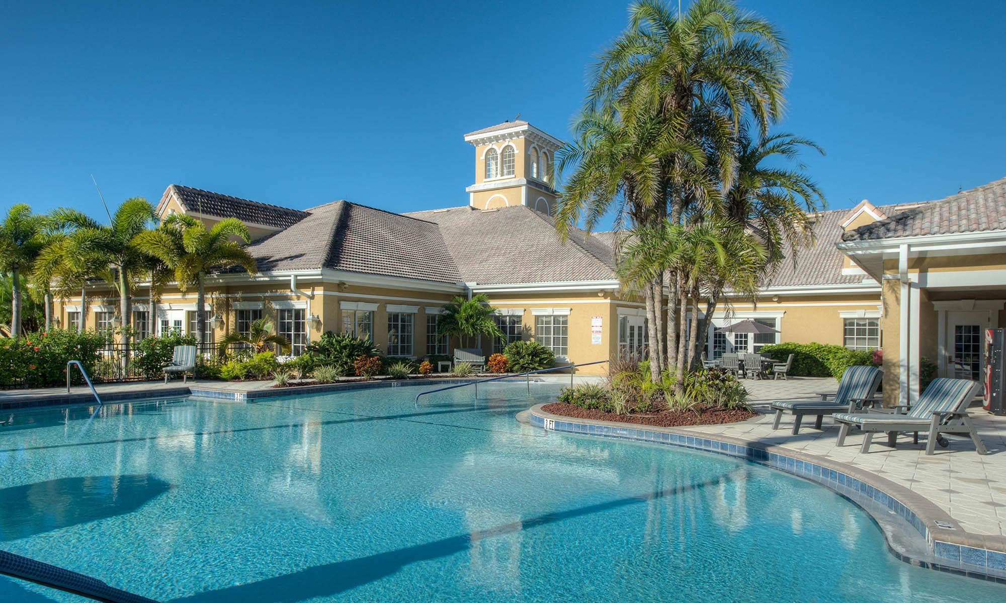 Relax by our amazing pool at Aston Gardens At Pelican Pointe