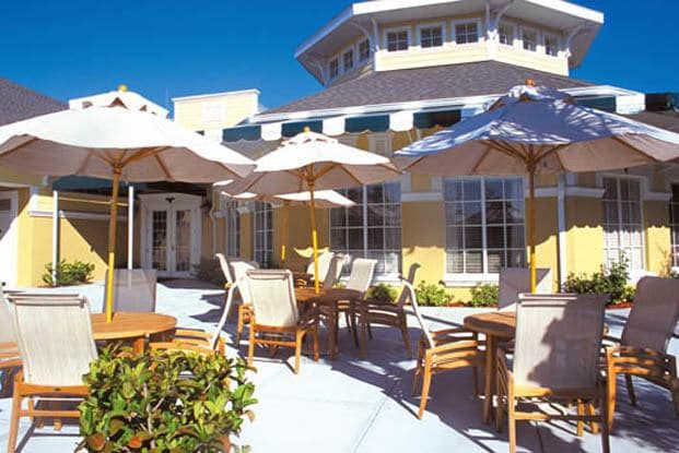 Relax on the Clubhouse patio with friends at Aston Gardens At Tampa Bay
