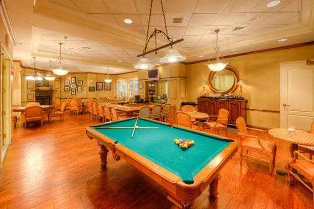 Play a game of billiards at Aston Gardens At Tampa Bay
