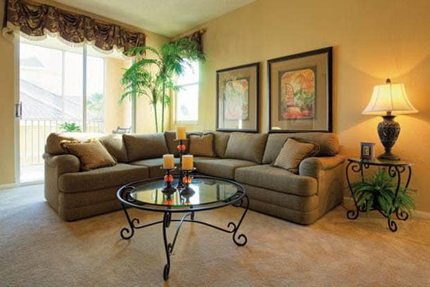 Your new beautiful living room awaits you at Aston Gardens At Tampa Bay
