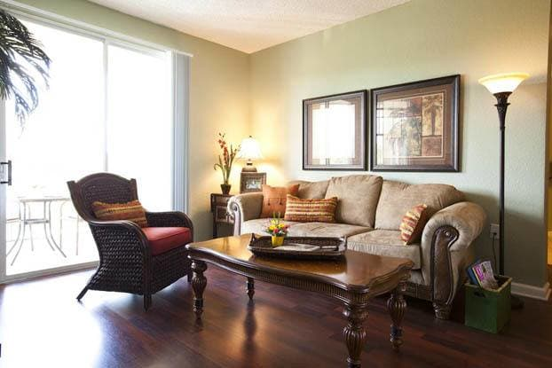 Hard wood floors and inviting living rooms at Aston Gardens At Tampa Bay in Tampa, FL