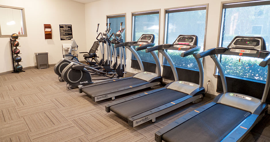 Modern fitness center at Promenade at Valley Creek in Irving, TX