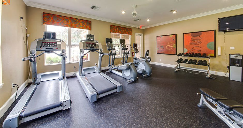 Fitness center at Stonecastle Apartments in Winter Park, FL