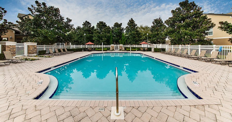 Luxury swimming pool at Stonecastle Apartments in Winter Park, FL