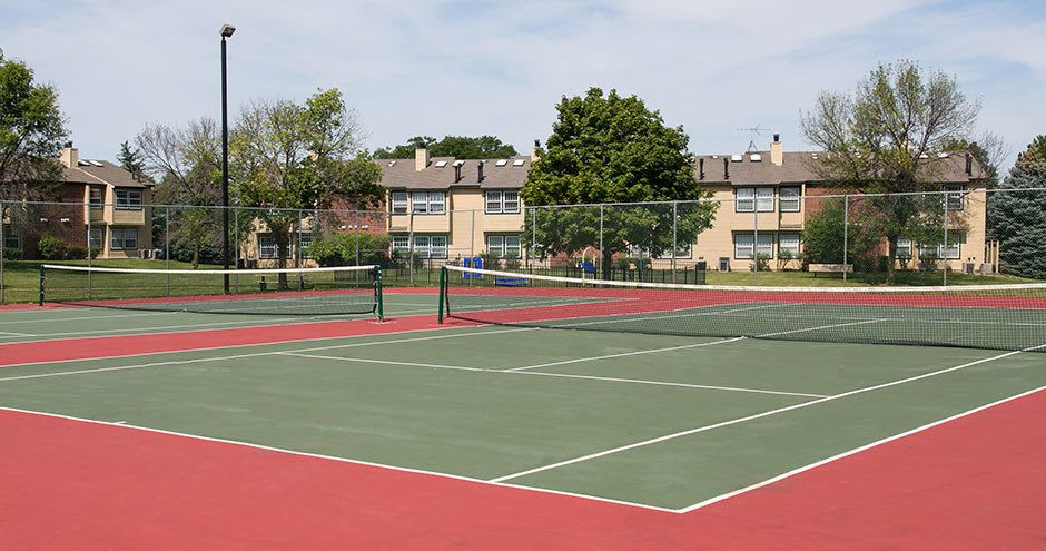 A tennis court that is great for entertaining at Windscape of Naperville Apartments in Naperville, IL