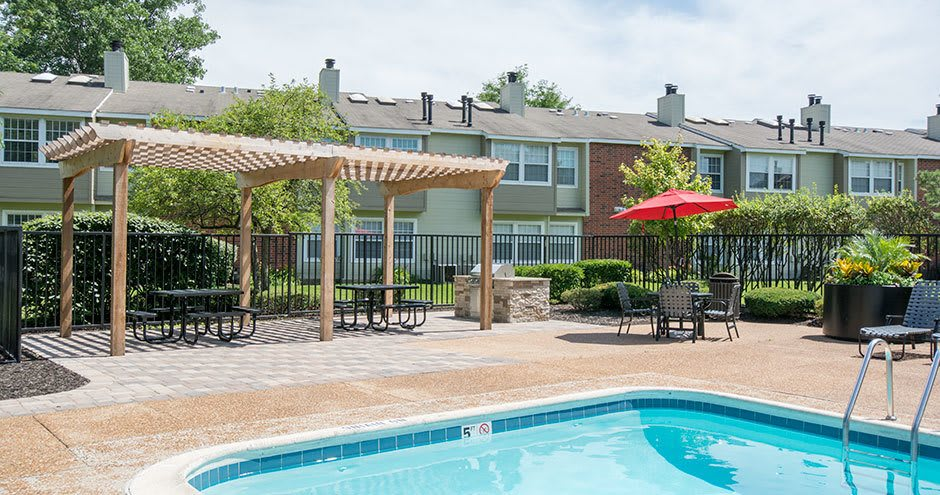 A swimming pool that is great for entertaining at Windscape of Naperville Apartments in Naperville, IL