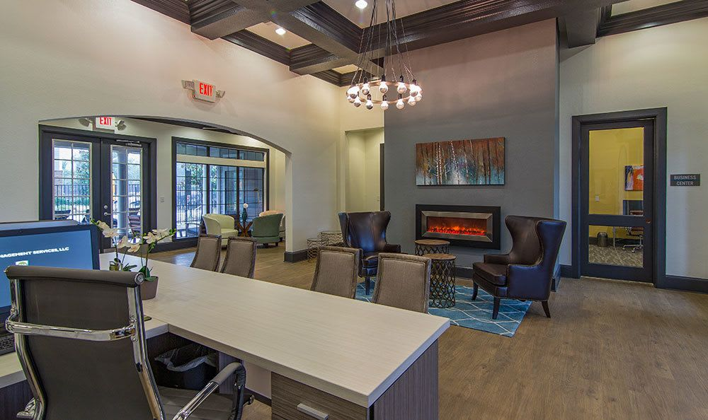 Spacious lobby with a gas burning fireplace at City Parc at Keller in Fort Worth, Texas
