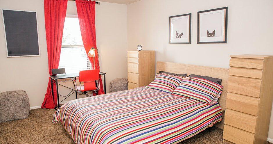 Enjoy a cozy bedroom at Carmel Landing apartments