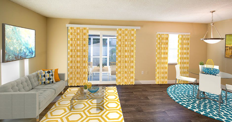 Enjoy a living room at Promenade at Uptown spacious apartments