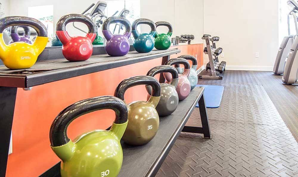 Modern fitness center at apartments in Deerfield Beach, Florida