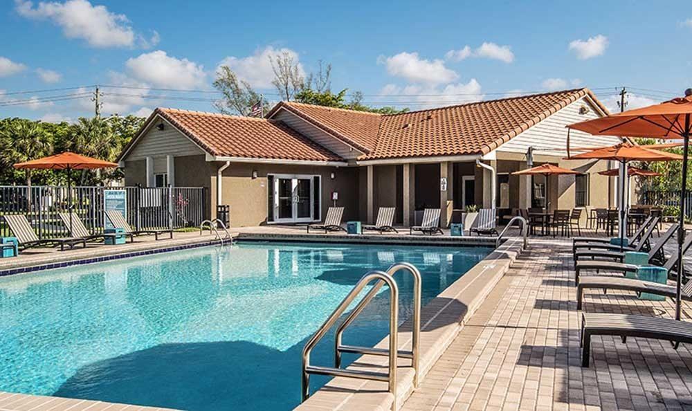 Beautiful swimming pool at Pavilions at Deer Chase in Deerfield Beach, Florida