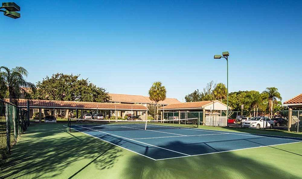 A tennis court that is great for entertaining at Pavilions at Deer Chase in Deerfield Beach, Florida