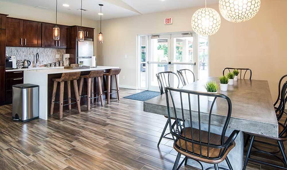 Spacious dining room of Pavilions at Deer Chase in Deerfield Beach, FL