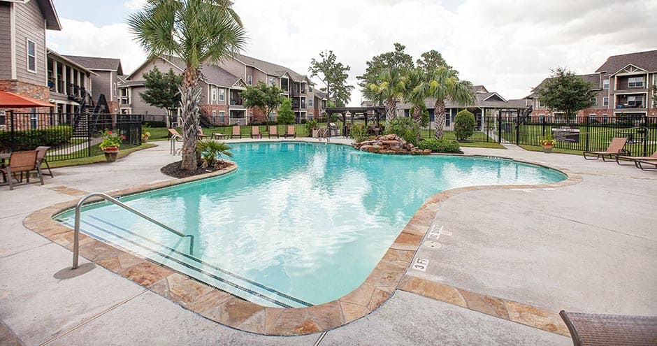 The Villages at Louetta offers a spacious swimming pool in Spring, TX