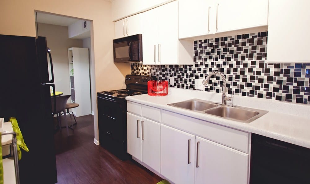 The black and white theme in the kitchen at The Ridge brings a modern feel to the home.