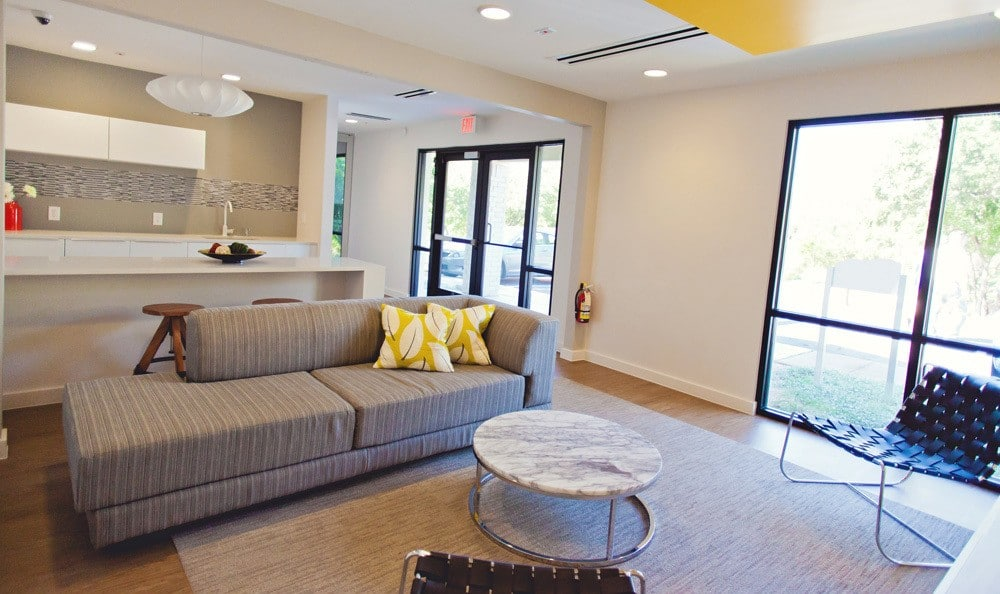 Living room with big windows at The Ridge.