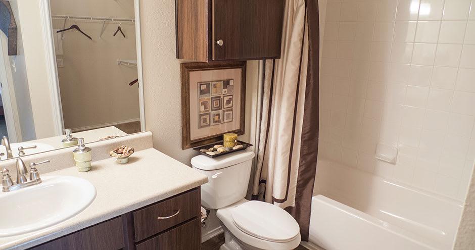 Beautiful bathroom at Republic Deer Creek Apartments in Fort Worth, TX