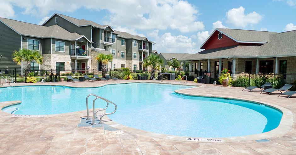 Spacious swimming pool at Republic Deer Creek Apartments in Fort Worth, TX