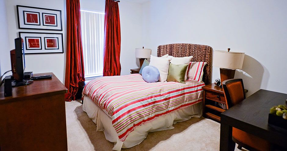 Cozy bedroom at Bristol Place Apartments in Baton Rouge, Louisiana