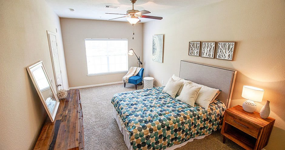 Luxury bedroom at apartments in Conroe, TX