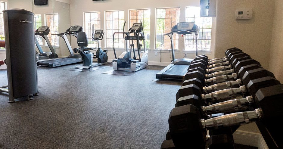 Spacious fitness center at Hawthorne Ridge Apartments in Conroe, Texas