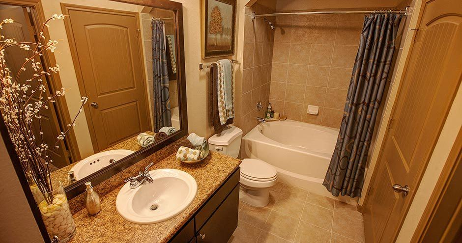Well-lit bathroom at Northgate Oaks Apartments in Houston, TX
