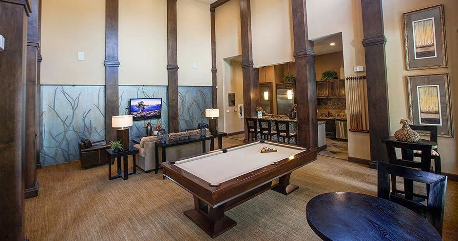 Enjoy apartments with a living room that is great for entertaining at Northgate Oaks Apartments
