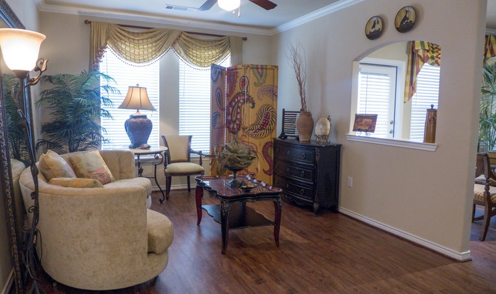 Living room with peek through view to the dining room at The Fountains of Conroe.