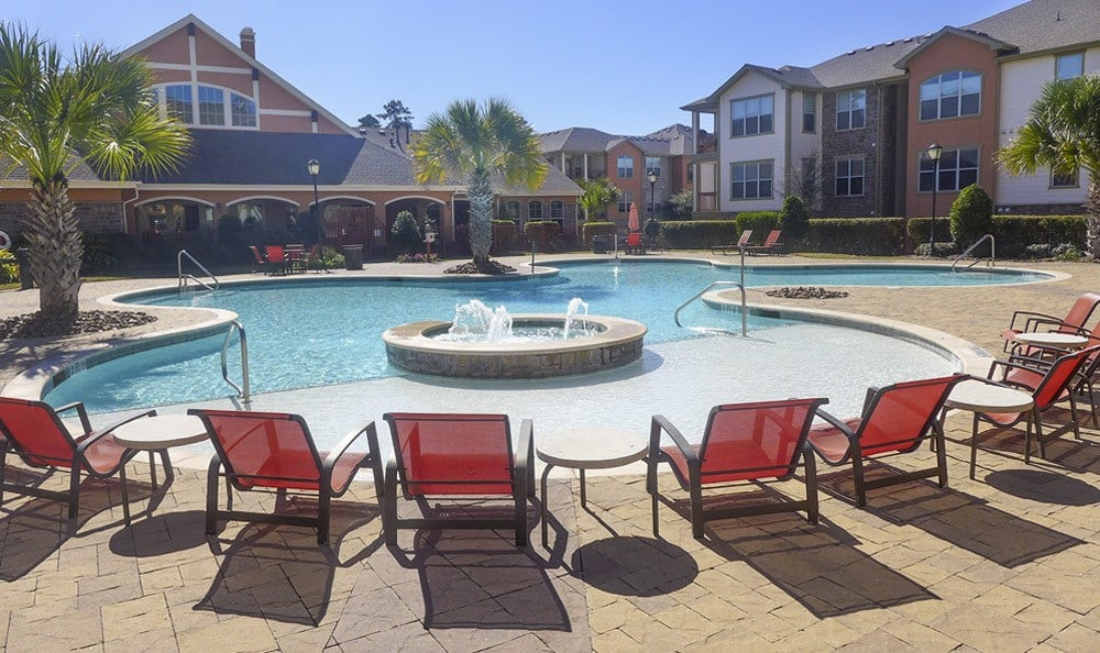 Lounging by the pool at The Fountains of Conroe.