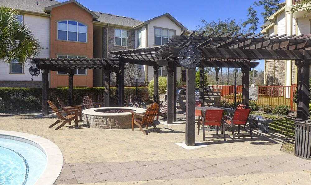 Pool side cabana with barbecue pit at The Fountains of Conroe.