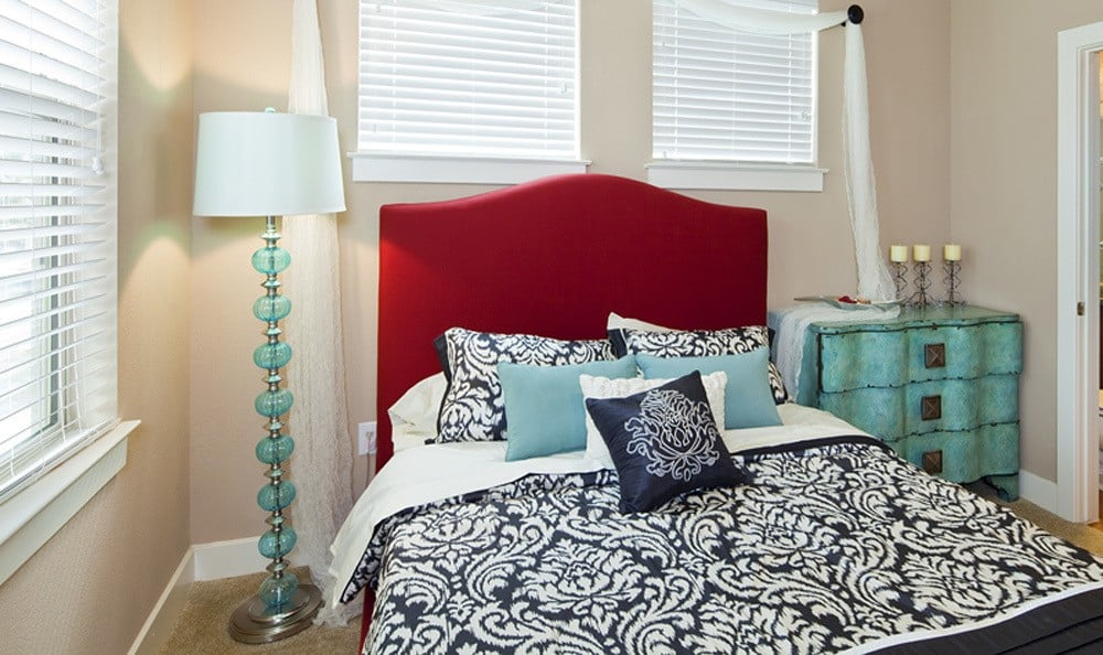 Bedroom with multiple bright windows at The Landings at Brooks City Base.