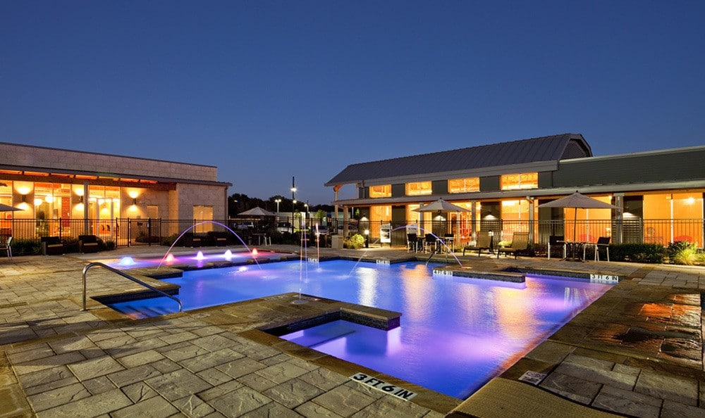 Inviting pool area during the day or night at The Landings at Brooks City Base.