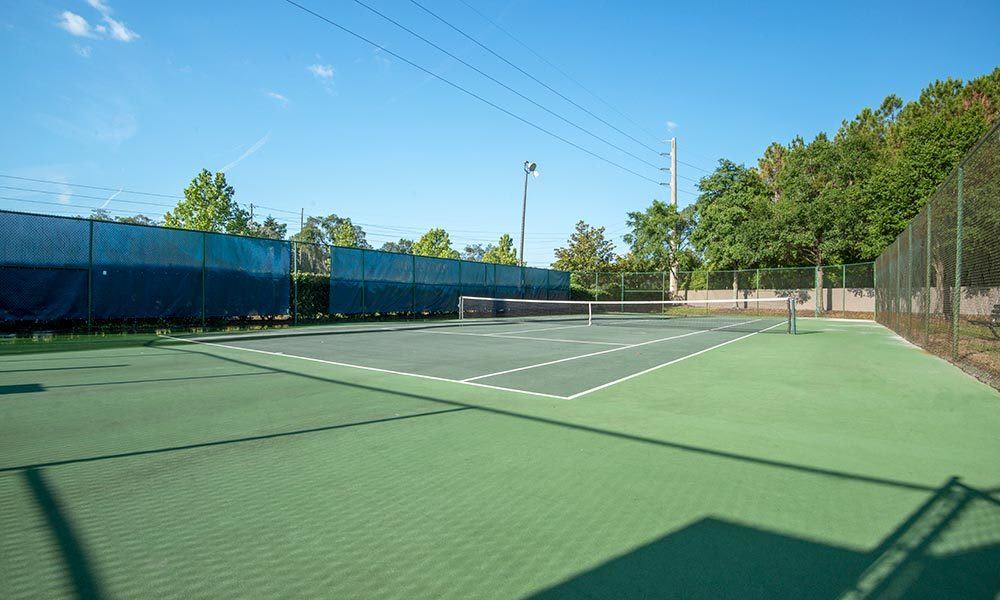 A tennis court that is great for entertaining at Promenade at Aloma in Oviedo, Florida