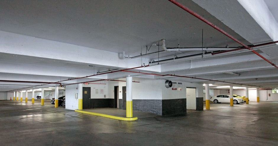 Spacious underground parking lot at apartments in Plantation, Florida
