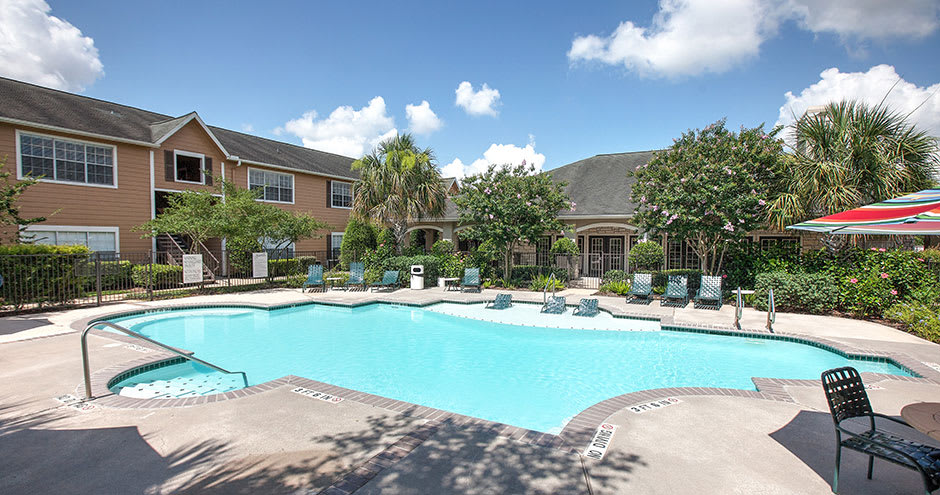A swimming pool that is great for entertaining at apartments in Katy, TX