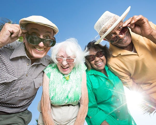 A smiling group of seniors enjoying the Regency Pacific lifestyle