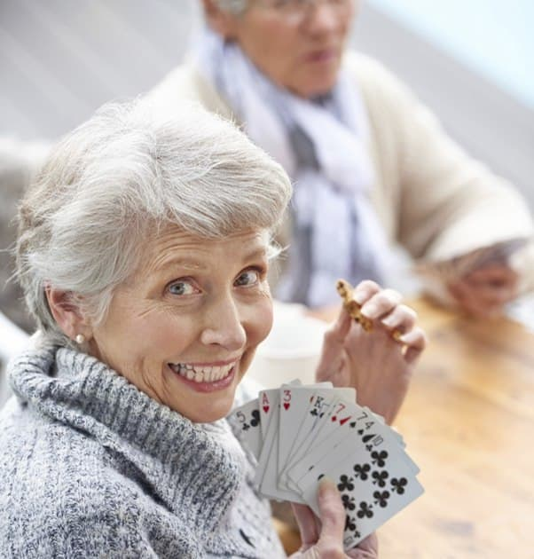 Seniors playing cards in Bend, OR.