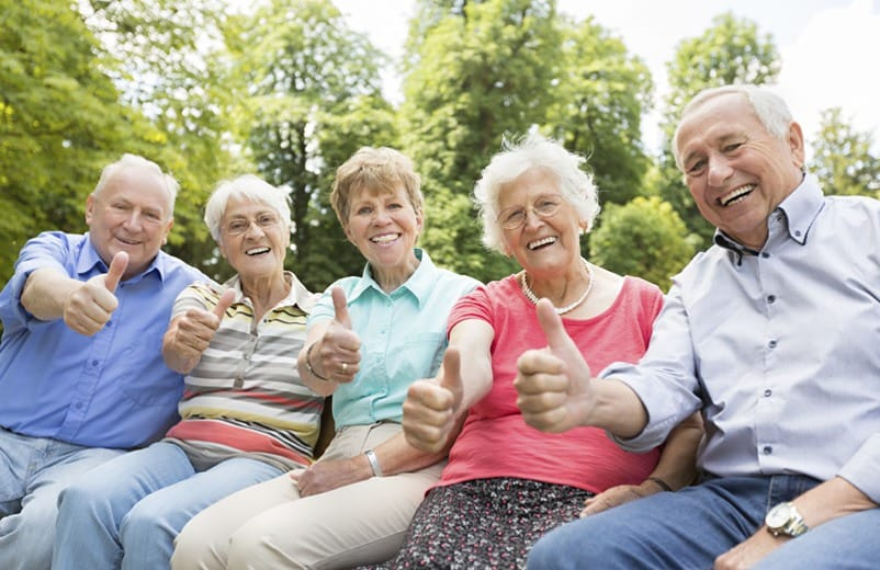 A group of happy residents enjoying their time together at Regency Columbia Village in Boise, Idaho.