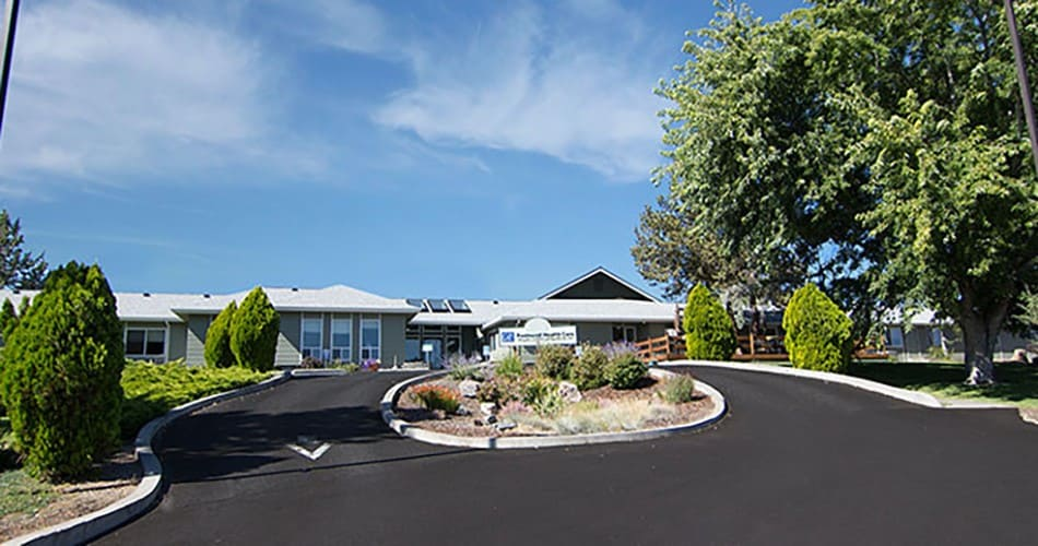 The common areas and landscaping at Regency Redmond Rehabilitation and Nursing Center in Redmond, Oregon, are very well maintained.