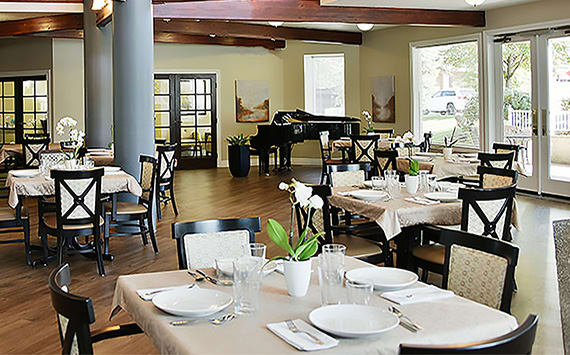 Attractive exposed beams in the dining room at Regency Village at Bend in Bend, Oregon