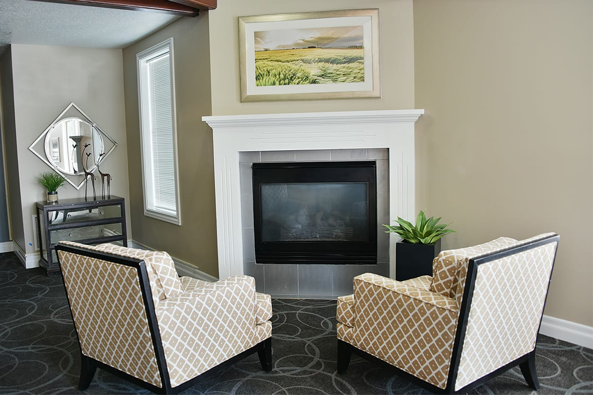Relax in front of the fire at Regency Village at Bend in Bend, Oregon
