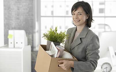 Woman carrying box to move to American Mini Storage