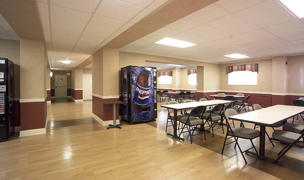 Common area with tables at Euclid Hill Villa