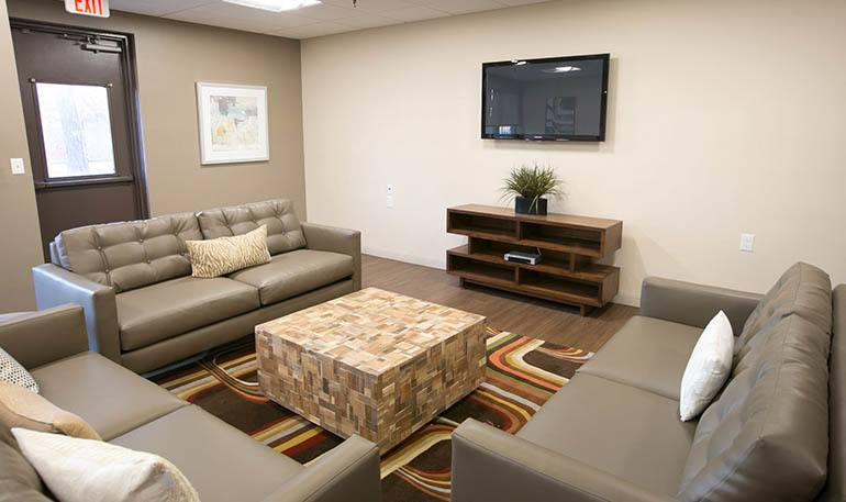Senior apartments in Detroit, MI have a relaxing common room