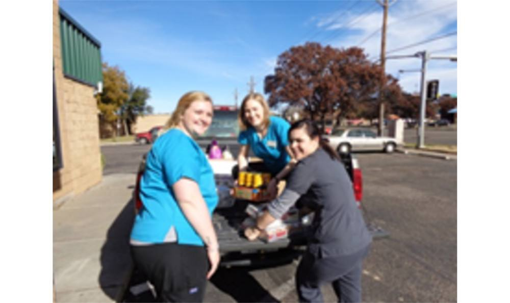 Employees unpacking a truck of supplies for Animal Hospital of Lubbock