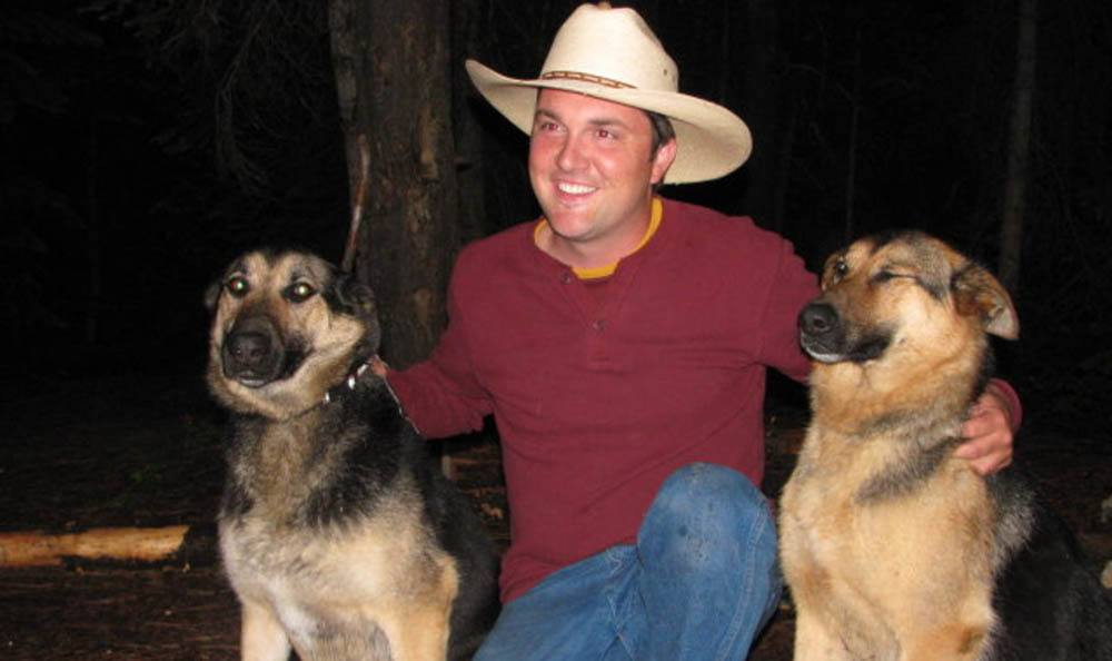 Cowboy With Two Dogs At Hendricks Veterinary Hospital